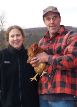 Joan and Don Hess holding one of their dancing hens.