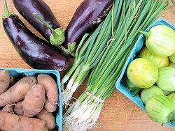 Two varieties of eggplant, with potatoes, and small green onions.